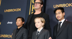 John, center, with dad and brothers at the 'Unbroken' premiere. (Photo: Matt Sayles, Invision/AP)